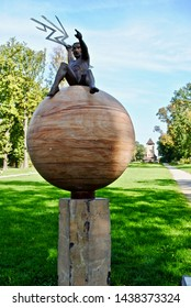Bad Nauheim, Germany/Oct 2013 - Jupiter, god of thunder, sits on the planet throwing lightning at Goldsteinpark. Planet Trail (PlanetenWanderweg) is a 2km trail with sculptures depicting the planets.