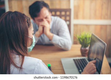 Bad news for medical diagnosis and assessment,Serious patients are listening x-ray scan results from professional doctor.Patient and doctor concept