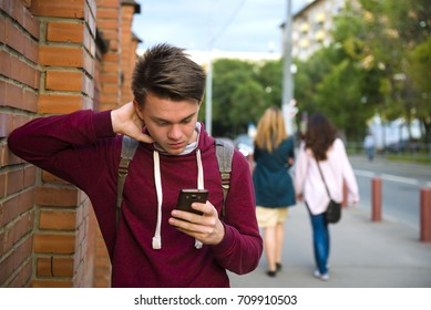 Bad news. Teen boy reads sms on smartphone