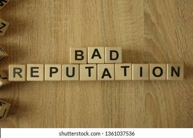 Bad reputation text from wooden blocks on desk