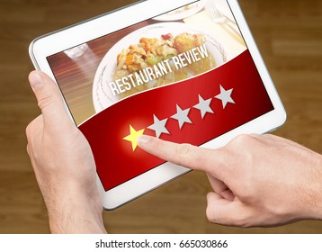 Bad restaurant review. Disappointed and dissatisfied customer giving terrible rating with tablet on an imaginary criticism site, application or website. One out of five stars to tavern, cafe or bistro