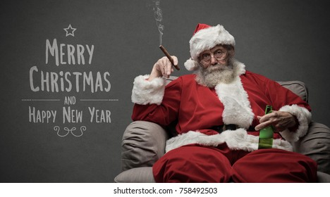 Bad Santa celebrating Christmas at home alone, he is smoking a cigar and drinking beer, Christmas card with wishes