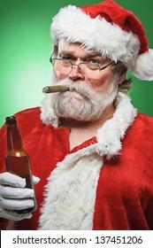 A bad Santa smoking a cigar and drinking beer.