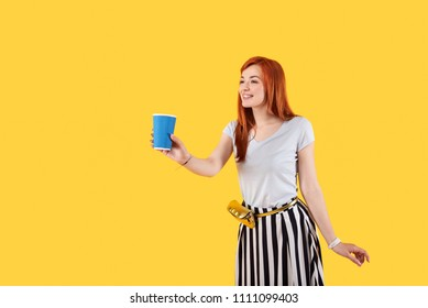 Bad situation. Delighted optimistic woman standing against yellow background while asking for money