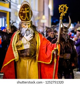 Bad Toelz, Germany - December 8: participant of a traditional pageant called krampuslauf with fantasy costumes and handmade wooden masks on December 8, 2018 in Bad Toelz, Germany