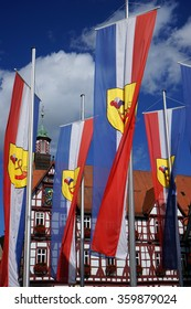 BAD URACH, GERMANY - CIRCA AUGUST 2015 Houses and flags on the Marktplatz square