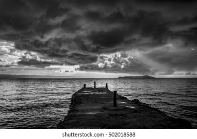 Bad weather above the Yumani dock at Lake Titicaca black and white