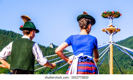 BAD WIESSEE, GERMANY - JULY 19: Bavarian dancing group at a summer festival showing a traditional ribbon dance in Bad Wiessee at july 19, 2016