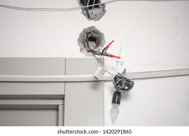 bad wiring  electrical wires protrude from the wall  lamp voltage