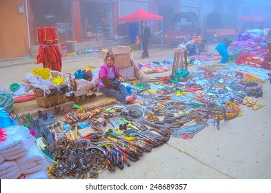 BADA, CHINA, NOVEMBER 18, 2013: traditional market taking place in chinese mountain village bada which is situated among yuanyang rice terraces in yunnan province.
