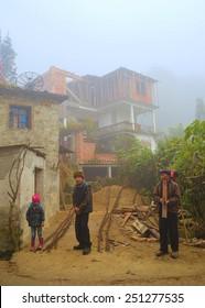 BADA, CHINA, NOVEMBER 18, 2013:chinese family is building house among yuanyang rice terraces in chinese province yunnan.