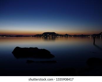 Badacsony hill from southern coast of Lake Balaton by night after sunset