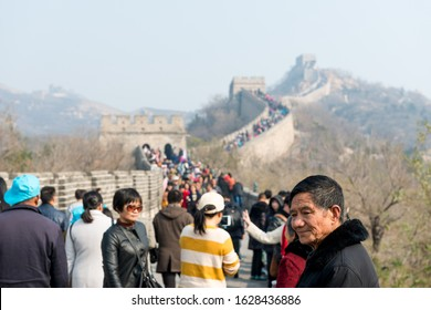 BADALING, CHINA - 2017: Tourists line the Great Wall at Badaling, China. Old man portrait