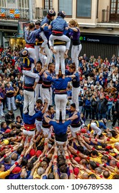 Badalona, Spain - May 13, 2018: Some unidentified people called Castellers do a Castell or Human Tower, typical tradition in Catalonia, Major festivals of the city.