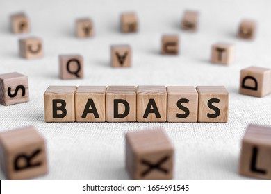 Badass - words from wooden blocks with letters, bad or slightly frightening person badass concept, white background
