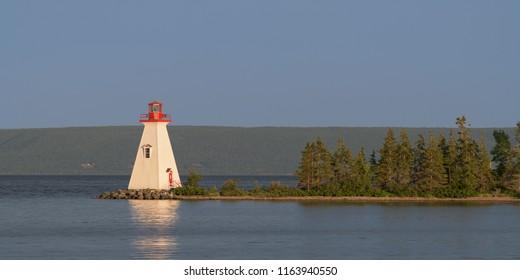 BADDECK, NOVA SCOTIA/CANADA - JULY 20, 2018: The Kidston Island Lighthouse at twilight in Baddeck