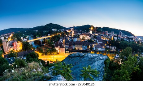 BADEN, AARGAU, SWITZERLAND - JULY 1: View from Mountain Lagern to the city of Baden and river Limmat at sunset on July 1, 2015. Baden is a municipality in the Swiss canton of Aargau.