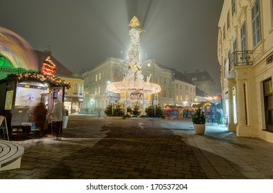BADEN, AUSTRIA - DECEMBER 23: Plague column illuminated for Christmas on December 23, 2013 in Baden. Baden is a spa town in the Austrian state of Lower Austria and the capital of the Baden district.