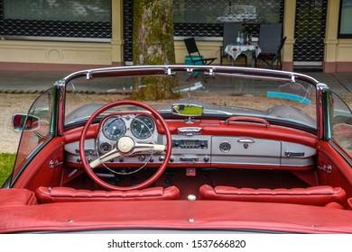 BADEN BADEN, GERMANY - JULY 2019: red leather interior of MERCEDES-BENZ 190 SL roadster cabrio 1955 1963, oldtimer meeting in Kurpark.
