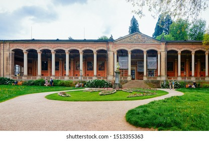 Baden Baden, Germany - May 6, 2013: Trinkhalle pump house spa resort complex in Kurpark of Old city of Baden Baden, Wurttemberg region, Germany. Cityscape view, Bath German town in Europe