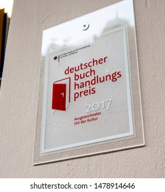 Baden-Baden, Germany - Jul 7, 2019: Deutscher buch handlungs preis for 2017 translated as The German Bookstore Award at the entrance of bookstore
