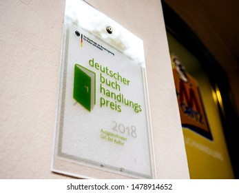 Baden-Baden, Germany - Jul 7, 2019: Deutscher buch handlungs preis for 2018 translated as The German Bookstore Award at the entrance of bookstore