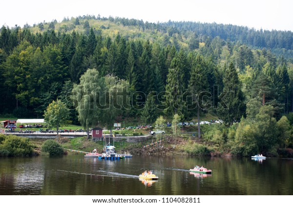 BADEN-WURTTEMBERG, GERMANY - AUGUST 27 : Travelers people playing and paddle boat in Schwarzenbachtalsperre Lake in Black Forest at Forbach village on August 27, 2017 in Baden-Wurttemberg, Germany