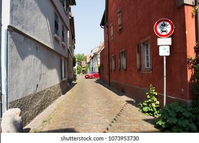 BADEN-WURTTEMBERG, GERMANY - AUGUST 28 : German people driving red sport car come in small alley in Ladenburg town on August 28, 2017 in Baden-wurttemberg, Germany