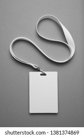 Badge, staff id mockup, name tag lanyard identification card on grey background.