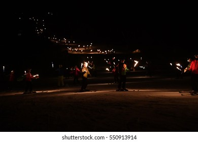 BADIA, ITALY - DECEMBER 31, 2016 - Traditional night ski torchlight procession for new year's eve