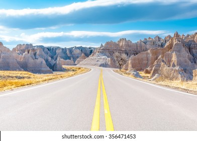Badlands Loop Road in Badlands National Park in South Dakota, USA. Cloudy Blue Sky - Summer Day