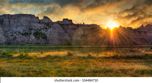 Badlands Prairie Sunrise - sun rises over ridges and grasslands of the Badlands in South Dakota