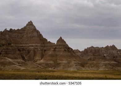 The Badlands in South Dakota with stormy skies.