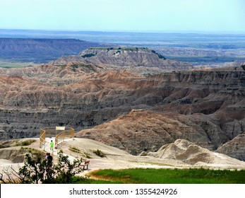 Badlands, South Dakota--July 2018: Amazing landscape at the Badlands National Park in South Dakota, with tourists heading to a view deck.
