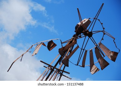 A badly broken windmill water pump in South Africa