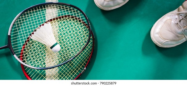 Badminton ball and racket on court floor