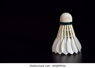 Badminton ball or shuttle cock on the black background with copy space for advertising, Sport concept, Fitness concept