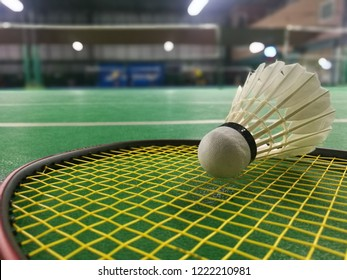 Badminton balls placed on a badminton racket.