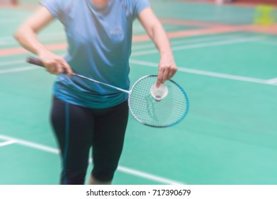 badminton court with blurred background woman playing badminton