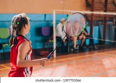 Badminton court with players. Tennis player with a racket. Badminton activity. Sports game of success. Happy kid playing badminton. The child beats the shuttle with a racket.