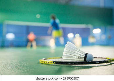badminton courts with players competing