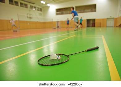 badminton courts with players competing. shallow DOF