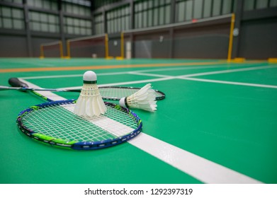 Badminton on a green floor  in badminton court.Concept background.
