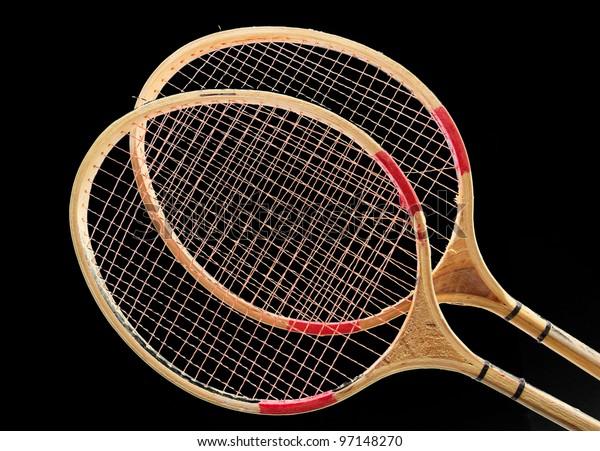 Badminton racket on a black background