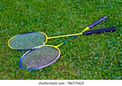 Badminton racket on grass and Shuttlecock