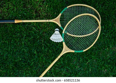 Badminton racket on the green , top view