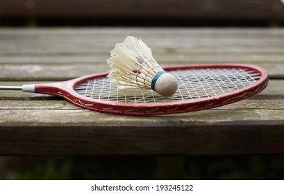 badminton racket on the old wooden table