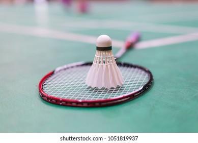 badminton racket and shuttlecock in badminton court.