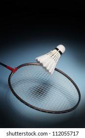 Badminton racket striking shuttlecock