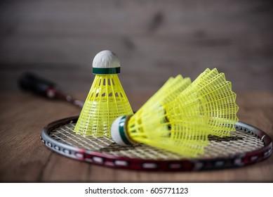 badminton racket with yellow balls